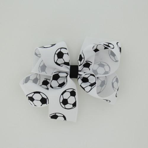 "Item no.: dgcssoc, Size: 6"" X 5"",  Color: White Black Center ""Soccer"",  Center: plain,  Ribbon Size: 1 1/2""   Type of Clip: Aligator clip        MADE IN USA"