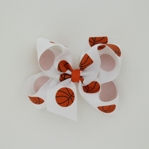 "Item no.: dgcbask, Size: 6"" X 5"",  Color: White Orange Center ""Basketball"",  Center: plain,  Ribbon Size: 1 1/2""   Type of Clip: Aligator clip        MADE IN USA"
