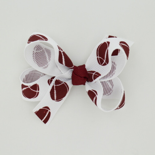 """Item no.: bgcsfot, Size: 3"""" X 2.5"""",  Color: White Burgundy Center """"Football"""",  Center: Cone,  Ribbon Size: 5/8""""   Type of Clip: Aligator clip        MADE IN USA"""