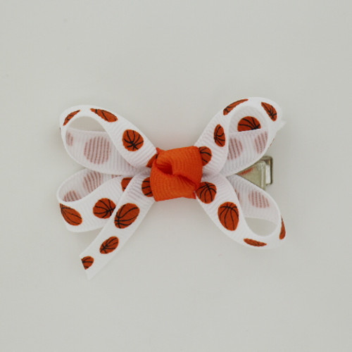 """Item no.: agcsbask,Size: 2.5"""" X 2"""",  Color: White Orange Center """"Basketball"""",  Center: Cone,  Ribbon Size: 3/8""""   Type of Clip: Aligator clip        MADE IN USA"""
