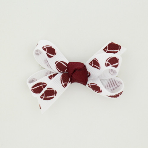 """Item no.: agcsfot, Size: 2.5"""" X 2"""",  Color: White Burgundy Center """"Football"""",  Center: Cone,  Ribbon Size: 3/8""""   Type of Clip: Aligator clip        MADE IN USA"""