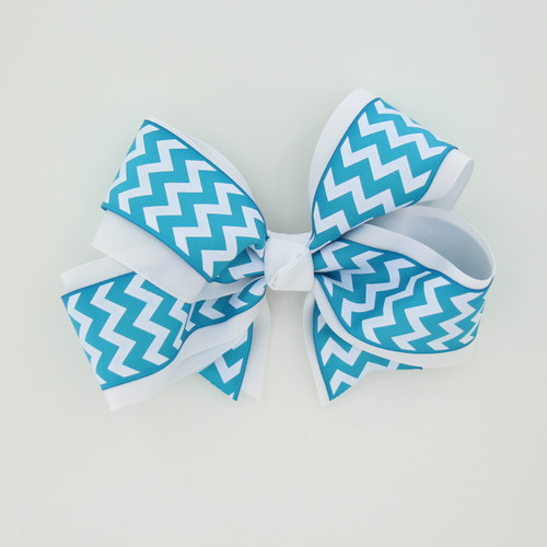 "Item No.:dgcchev   Size: 7""X5""  Color: White/Blue Chevron  Center: Cone  Ribbons Size: 2 1/4""/ 1 1/2""  Type of Clip: French Clip  MADE IN USA"