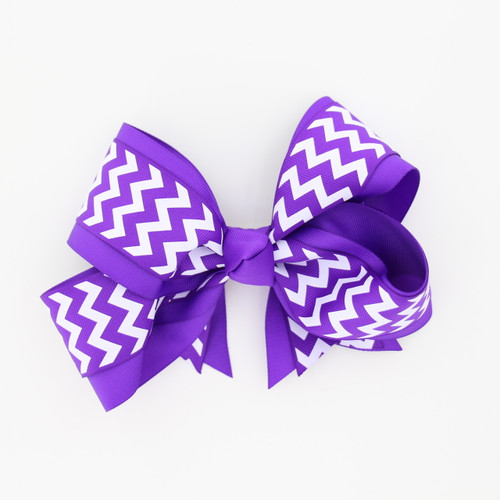 "Item No.:dgcchev   Size: 7""X5""  Color: Purple/Purple Chevron  Center: Cone  Ribbons Size: 2 1/4""/ 1 1/2""  Type of Clip: French Clip  MADE IN USA"
