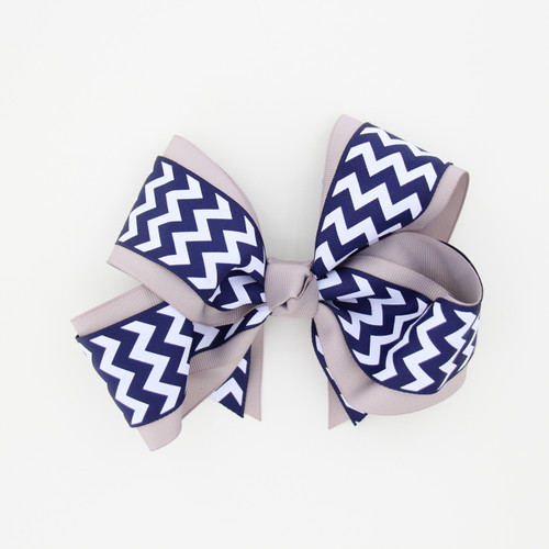 "Item No.:dgcchev   Size: 7""X5""  Color: Silver/Navy Chevron  Center: Cone  Ribbons Size: 2 1/4""/ 1 1/2""  Type of Clip: French Clip  MADE IN USA"