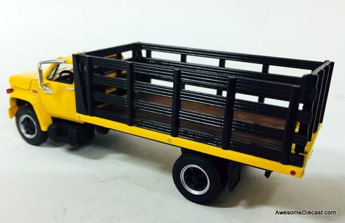 First Gear 1:64 GMC 6500 Single Axle Stake Truck, Yellow/Black