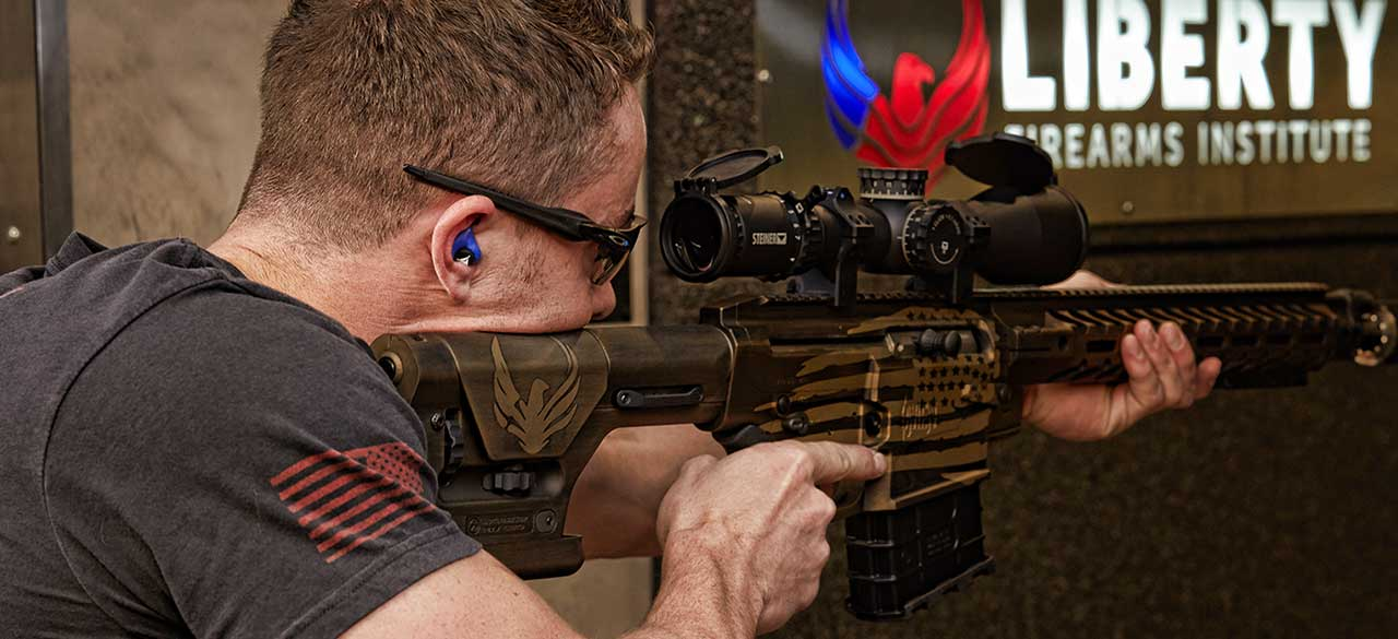 sport shooter using decibullz hearing protection while shooting at target