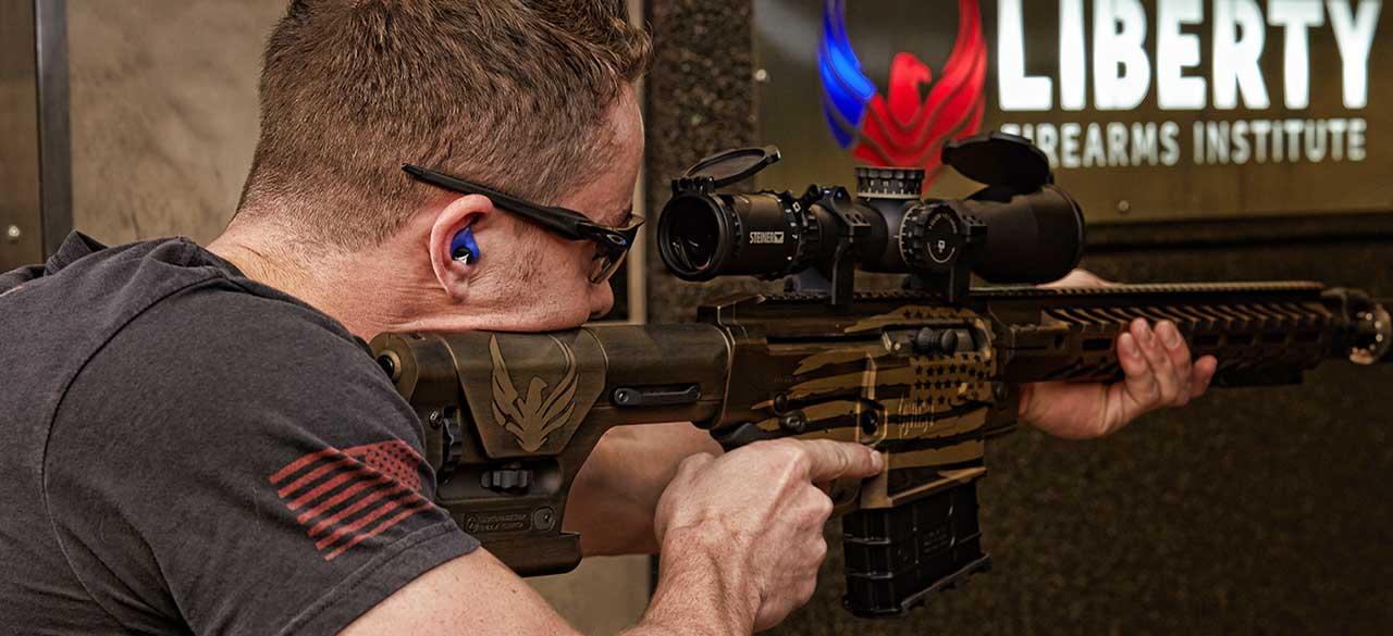 sport shooter using decibullz hearing protection while shooting at target