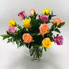 Rainbow of Roses showcases a variety of multi-colored short stem roses beautifully arranged in a vase in Rockville MD, Palace Florists