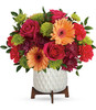 Mid Pike Brights features hot pink roses, peach gerberas, hot pink carnations, green cushion mums, purple spray mums and greens designed in a geometric planter in Rockville MD, Palace Florists