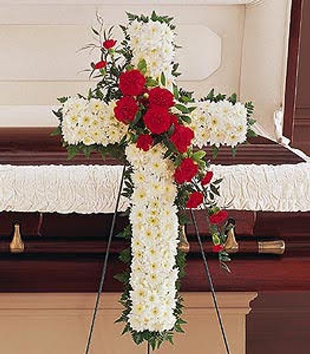 Hope and Honor Cross with all white chrysanthemum solid flower cross on an easel decorated with a cluster of red carnations in Rockville MD, Palace Florists