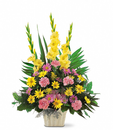 Warm thoughts showcases pink carnations, yellow and lavender daisies, and yellow gladioli, along with a pink ribbon, is delivered in a white container in Washington DC and Rockville MD, Palace Florists