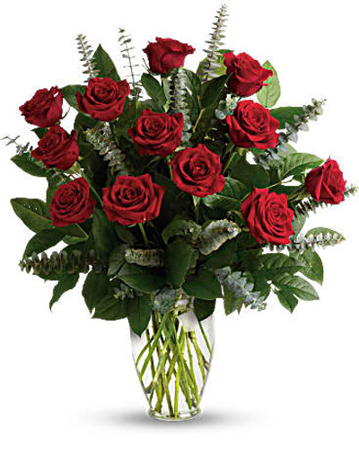 One dozen royal roses red accented with eucalyptus beautiful foliage in clear glass vase in Washington DC and Rockville MD, Palace Florists