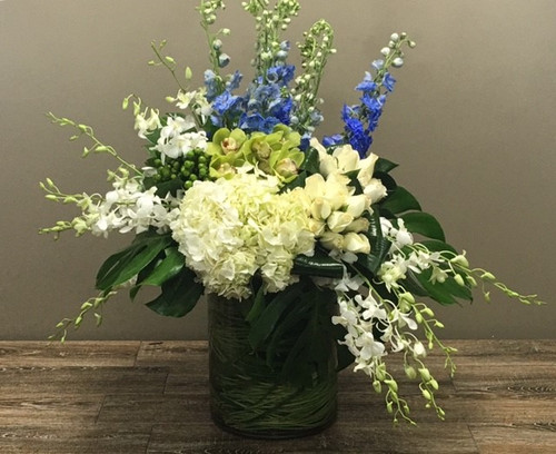 Skyline showcases orchids, roses, hydrangea and other beautiful flowers in a glass cylinder in Rockville MD, Palace Florists