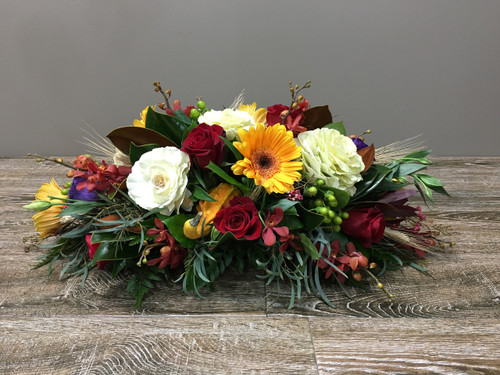 Fall Nights Centerpiece showcases beautiful fall colors with roses, gerber daisies,  lysinathis, foliage and accent flowers in Rockville MD, Palace Florists