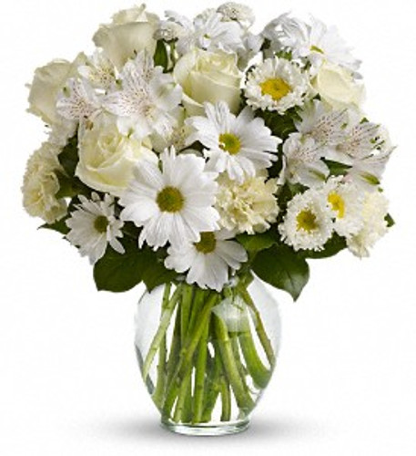 Purest Intentions showcases  alstroemeria, matsumoto asters, carnations, daisy spray chrysanthemums and button spray chrysanthemums accented with assorted greenery in clear glass vase Rockville MD, Palace Florists