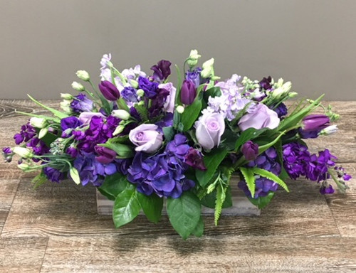 Lots of Lavender showcases purple hydrangea, purple roses, purple stock and purple tulips in Potomac MD, Palace Florists