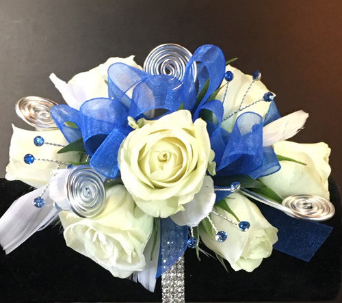 Blue Belle wrist corsage in Rockville MD, Palace Florists