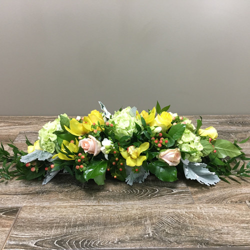 Sweet Surprises centerpiece showcases yellow orchids, green hydrangea, peach roses and more in Potomac MD, Palace Florists
