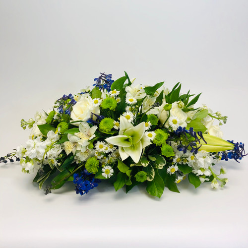 Traditional Blue and White centerpiece showcases lilies, roses, alstromeria and a touch of blue delphinium in Rockville, MD