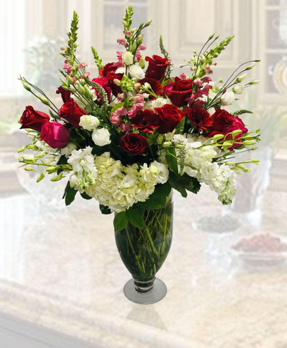 All About Romance  is a stunning display of vibrant reds and whites - roses, snapdragon, hydrangea, lysianthis and more will sure show your true love in Arlington VA, Palace Florists