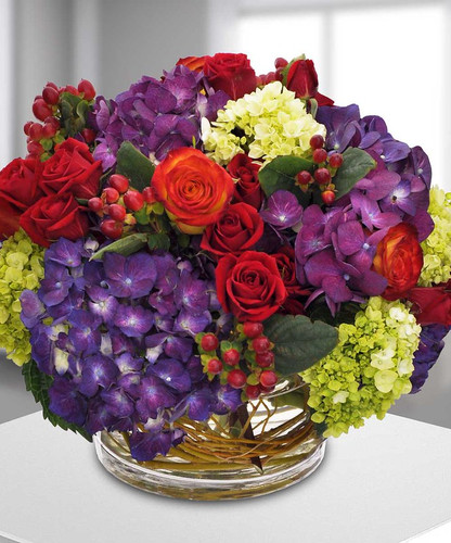 Sugarplum is filled with roses, hydrangea and more designed in a cylinder in Potomac MD, Palace Florists