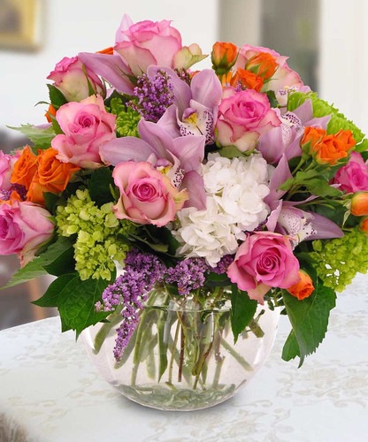 Floral Embrace showcases roses, cymbidium, hydrangea and more in a glass bubble bowl in Arlington VA, Palace Florists