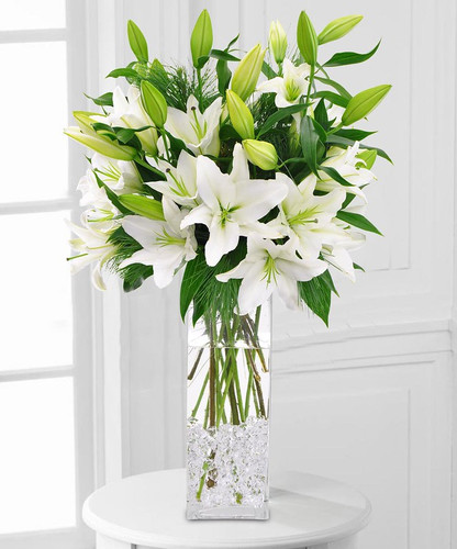 Starry NIght is a beautiful display of white lilies in a tall cylinder in Chevy Chase Chase MD, Palace Florists
