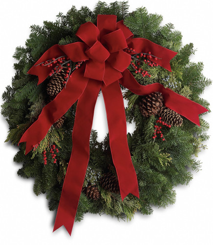 Classic Holiday noble fir wreath with juniper branches, pinecones and berry sprays is adorned with a brilliantly festive red velvet bow in Bethesda MD, Palace Florists