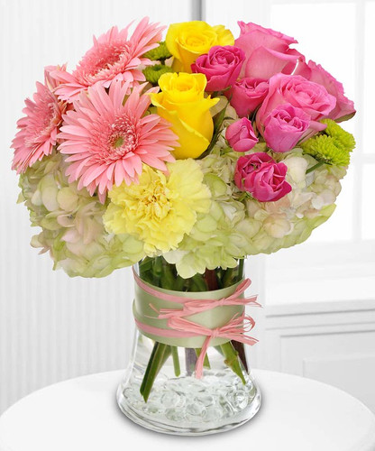 Fashionista Blooms can be delivered without contact to your loved one. It is a beautiful assortment of pink, yellow and green flowers in Rockville MD, Palace Florists