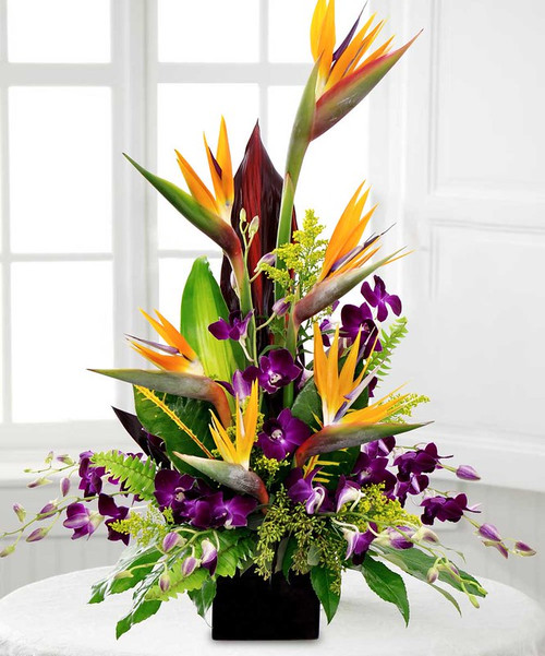 Royal Birds of Rockville is a fabulous design featuring birds of paradise, purple dendrobiums and foliage in Rockville MD, Palace Florists