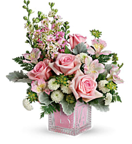 Bundle of Joy  features pink roses, pink alstroemeria, white cushion spray chrysanthemums, and pink larkspur are accented with bupleurum, dusty miller, leatherleaf fern hand-delivered in an adorable Baby Block in Washington DC, Palace Florists