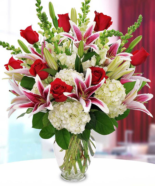 Passionate Love is a showstopper featuring gorgeous roses, hydrangea and stargazer lilies in Washington DC, Palace Florists