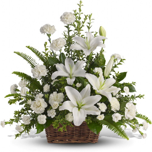 Peaceful White Lilies Basket with white flowers such as white lilies, white carnations and white miniature carnations mixed with vibrant greens in Washington DC and Rockville MD, Palace Florists