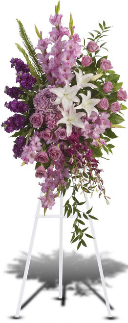 Sacred Garden Spray showcases a lavender spray of flowers such as roses, orchids, lilies, stock and beautiful foliage in Washington DC and Rockville MD, Palace Florists