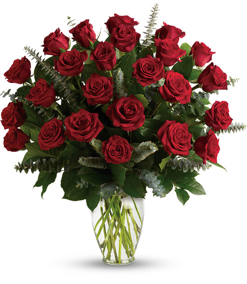 Two dozen royal roses red accented with eucalyptus in clear glass vase in Washington DC and Rockville MD, Palace Florists
