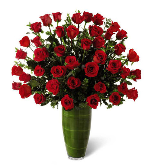Three dozen royal roses with accent flowers and foliage in a clear vase in  Rockville MD, Palace Florists