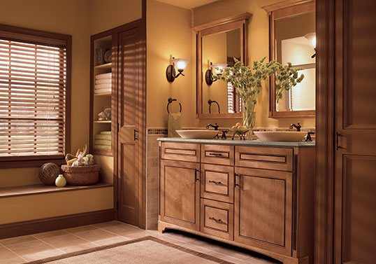 Transitional bathroom with two vessel sinks on top of a KraftMaid vanity in Ginger with Sable Glaze