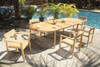 Teak oval table and 6 Montclair teak stacking chairs by the pool.