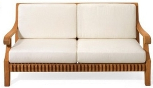 Teak loveseat sofa with soft outdoor cushions.