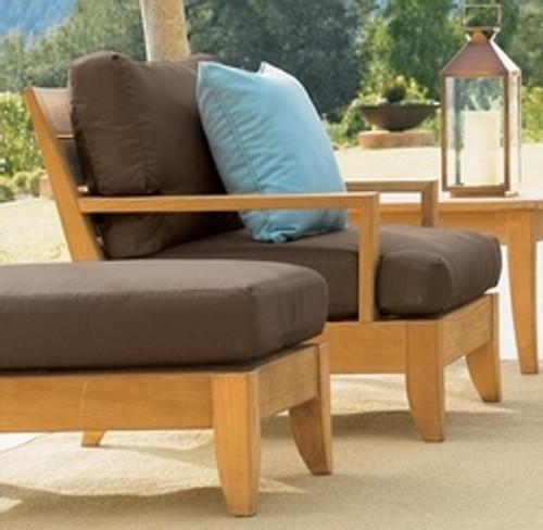 modern teak club chair with wide arm rest.
