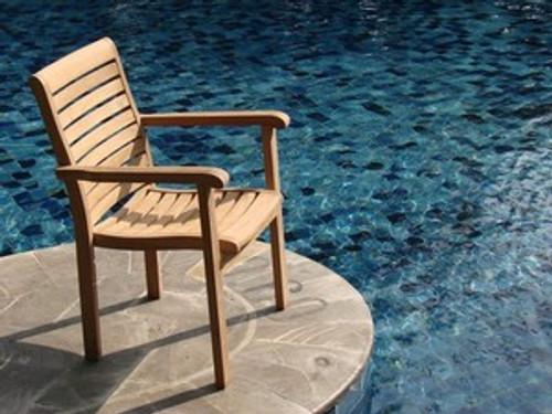 teak cypress chair by the pool