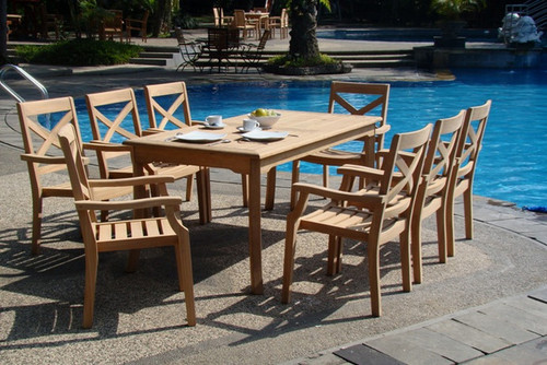 Dardanelle teak Stacking Chairs with rectangle table by the pool.