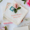 Ivory Lace handkerchief with custom embroidery in peach embroidery thread.