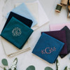 Solid color men's handkerchiefs. Samples of what the handkerchiefs look like when they are monogrammed.