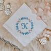 Something blue wedding handkerchief with monogram embroidered in powder blue.