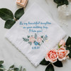 Bridal handkerchief to daughter from her parents. Embroidered with powder blue text with personalized wedding date and beautiful flowers.