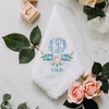 Bridal handkerchief with the bride's monogram and wedding date. Embroidered The text is embroidered in powder blue and accented with beautiful flowers.
