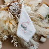 Embroidered initial handkerchief with flower bouquet and lace. Handkerchief is white with blush initial and sage color vines.