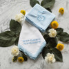 Something Blue embroidered handkerchief shown with men's powder blue handkerchief. Both are embroidered with powder blue embroidery thread.