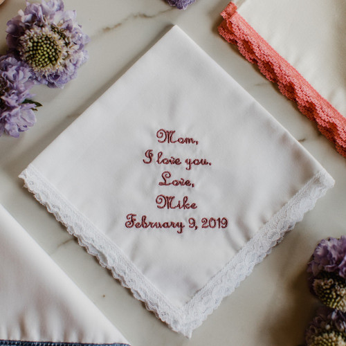 Embroidered wedding handkerchief for Mother of the Bride or Mother of the Groom with a simple I love you message that is personalized with your name and wedding date. Embroidery is shown in dusty rose thread.